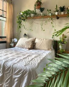 a-welcoming-boho-spring-bedroom-in-neutrals-with-potted-greenery-and-some-accessorie-sis-welcoming