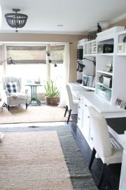 a-welcoming-farmhouse-home-office-with-a-large-storage-desk-built-in-unit-white-chairs-plaid-touches-and-a-beaded-chandelier