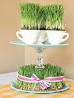 a-whimsical-centerpiece-with-wheatgrass-and-a-stand-with-teacups-with-wheatgrass-is-a-creative-idea-for-spring