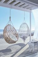 a-white-beach-deck-with-a-vintage-stool-pendant-wicker-chairs-and-white-textiles-seems-ethereal-and-chic