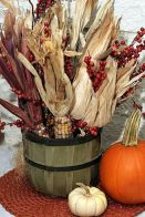 a-wooden-basket-with-berries-and-corn-husks-plus-pumpkins-next-to-it-compose-a-lovely-rustic-decoration
