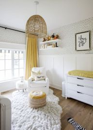 an-airy-and-funny-nursery-with-spot-wallpaper-white-furniture-a-wicker-lamp-and-some-yellow-touches-linens-and-an-ottoman