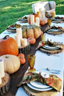 an-all-natural-Thanksgiving-tablescape-with-tree-stumps-heirloom-pumpkins-candles-bright-printed-napkins-and-colored-glasses