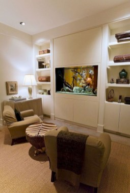 an-eclectic-neutral-living-room-with-a-vuilt-in-fish-tank-instead-of-a-TV-is-a-very-natural-and-cozy-idea