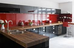 dark-kitchen-with-red-backsplash