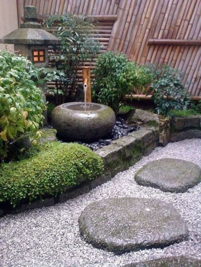 pebbles-rocks-grass-shrubs-a-stone-bowl-fountain-and-a-stone-lantern-for-a-lovely-and-chic-Japanese-front-yard
