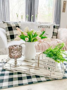 refresh-your-monochromatic-living-room-with-pink-blooms-greenery-and-pink-linens-and-make-it-feel-like-spring