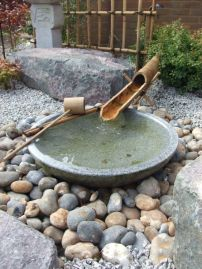 rocks-pebbles-a-stone-bath-and-bamboo-fountain-greenery-and-mini-trees-for-a-Japanese-feel-in-your-space