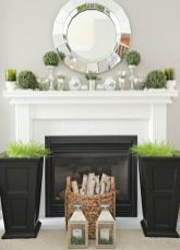 tall-black-planters-with-wheatgrass-a-basket-with-firewood-greenery-topiaries-on-stands-and-mercury-glass-candleholders