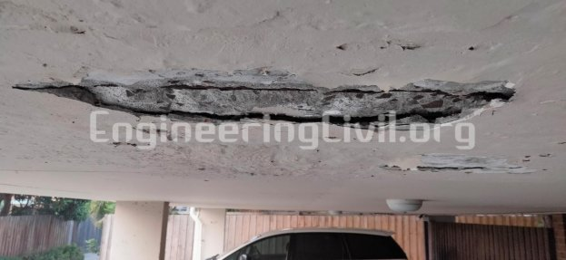 Deterioration and spalling of concrete slab in parking lot - EngineeringCivil.org