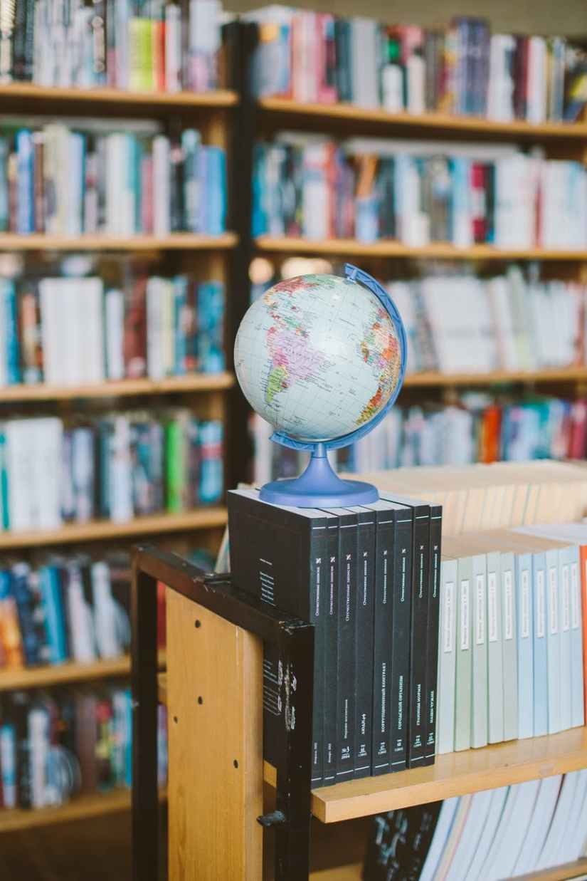 Indoor Mapping photo of globe on top of books