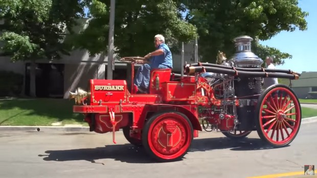 Jay Leno riding a 1913 Christie fire engine with a 20 L four-cylinder
