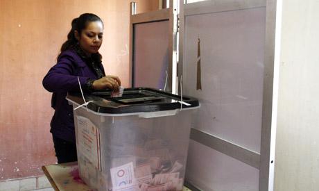 A woman casts her ballot