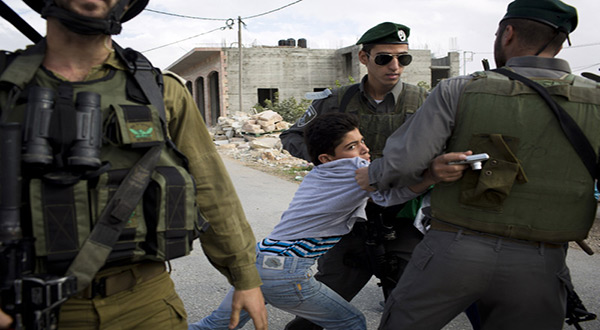 Palestinian boy arrested by