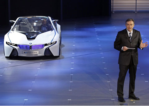 BMW CEO Norbert Reithofer showcases this years strategic  model at the Beijing Motor Show on Saturday. /Reuters-Yonhap