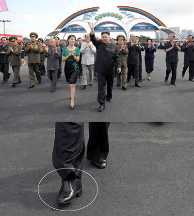 North Korean leader Kim Jong-un (front right) wears Cuban heels during a visit to an amusement park in Pyongyang with his wife Ri Sol-ju (front left) on Wednesday. /[North] Korean Central News Agency-Yonhap
