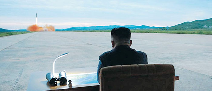 Image result for Kim Jong un watches missile launch with binoculars