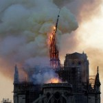 Notre-Dame fire under control, Macron vows to rebuild