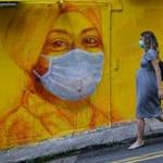 Britain orders lockdown as WHO warns pandemic 'accelerating'