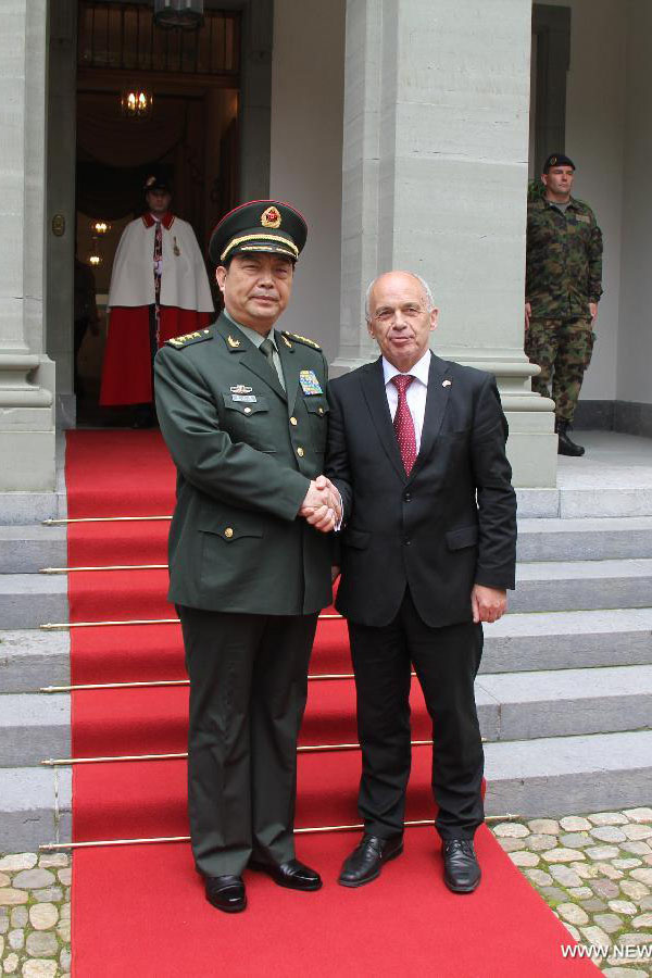 Visiting Chinese defense minister meets with his Swiss ...