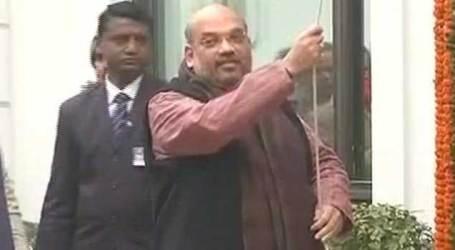 Amit Shah unfurls national flag at BJP office