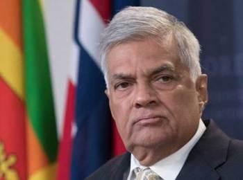 Sri Lanka reinstates ousted prime minister: official