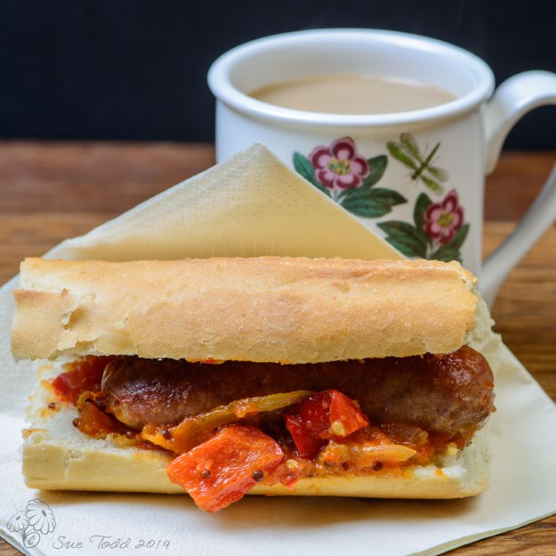 Breakfast to go - Sausage Sandwich, home-made ketchup and coffee © Sue Todd 2014