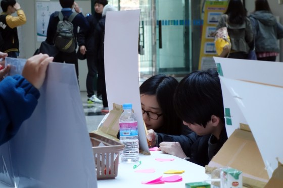 Students share their thoughts on the disabled. (PHOTO: Charles Ian Chun)