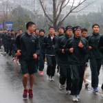 Kangnam University's ROTC students slog through the rain on a Monday morning jog around campus. (Photo: Charles Ian Chun)