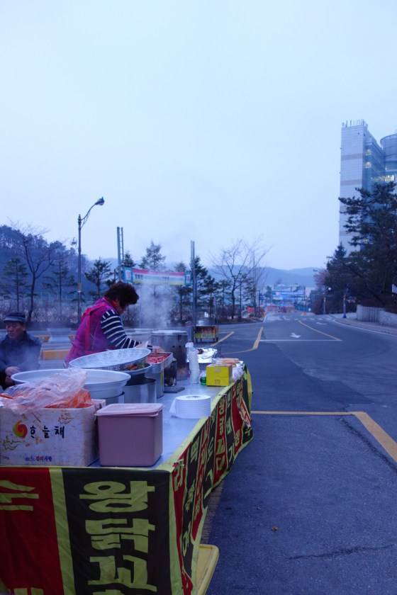 Food and drink vendors have arrived as early as 5 a.m. in -3° weather to set up shop before Kangnam University's graduation ceremony. (Photo: Charles Ian Chun)