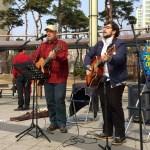 Eldin Husic and Onur Sahil of The Light perform at Dongbaek Lake Park. (Photo: Charles Ian Chun)
