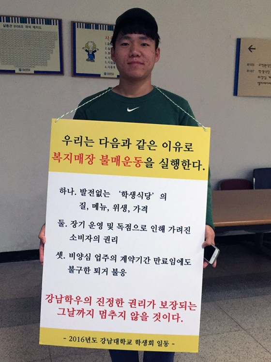 A member of student council PACE works between classes to raise awareness. Photo: Charles Ian Chun