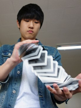 1st-year English Literature student and amateur magician Jeon Hyun Woo demonstrates his skill with cards. (Photo: Charles Ian Chun)