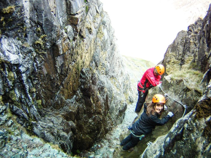 Navigating ladders overhanging a steep gully