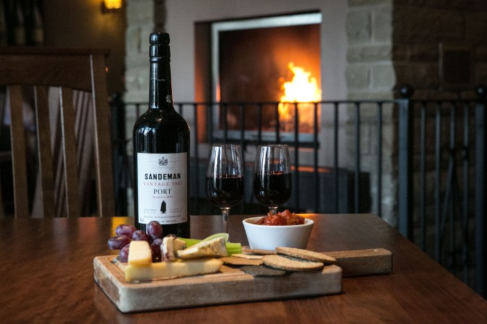 A Bottle of Sandeman Port and a selection of local cheese