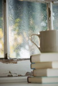 Rain observed from the inside with a cup of coffee