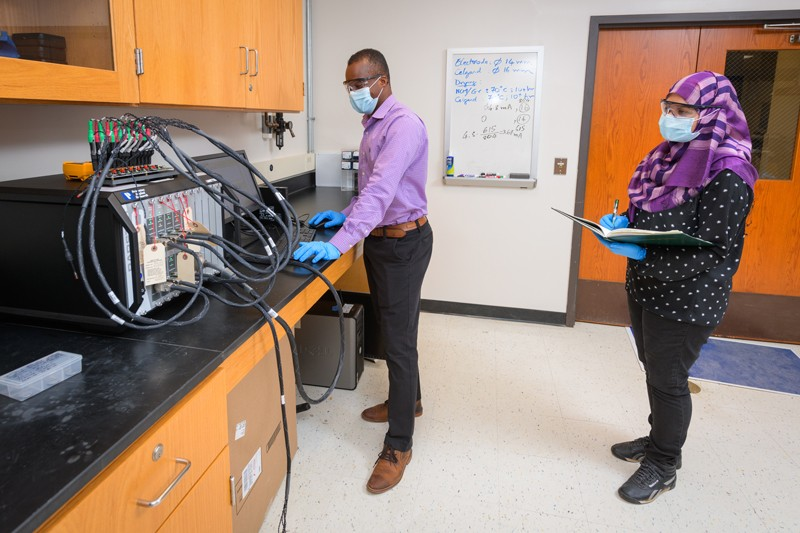 Prof. Koffi Pierre Yao mentors doctoral candidate Rownak Jahan Mou as they work to create a better (and more affordable) lithium ion battery for electric vehicles.