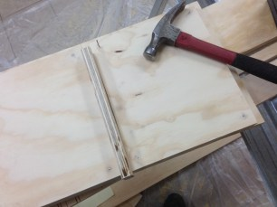 Using a plywood scrap as a spacer.