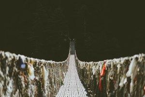 Taking a leap by walking a rope bridge