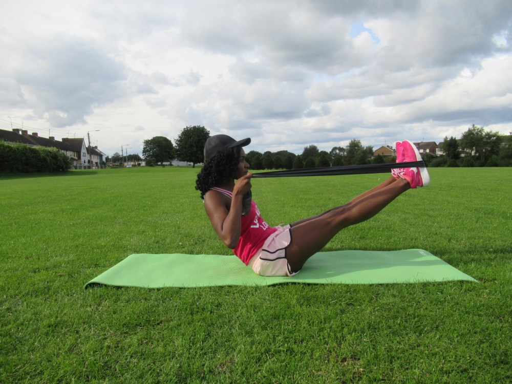 10 Resistance Band Workouts For Abs Enhance What S Yoursenhance