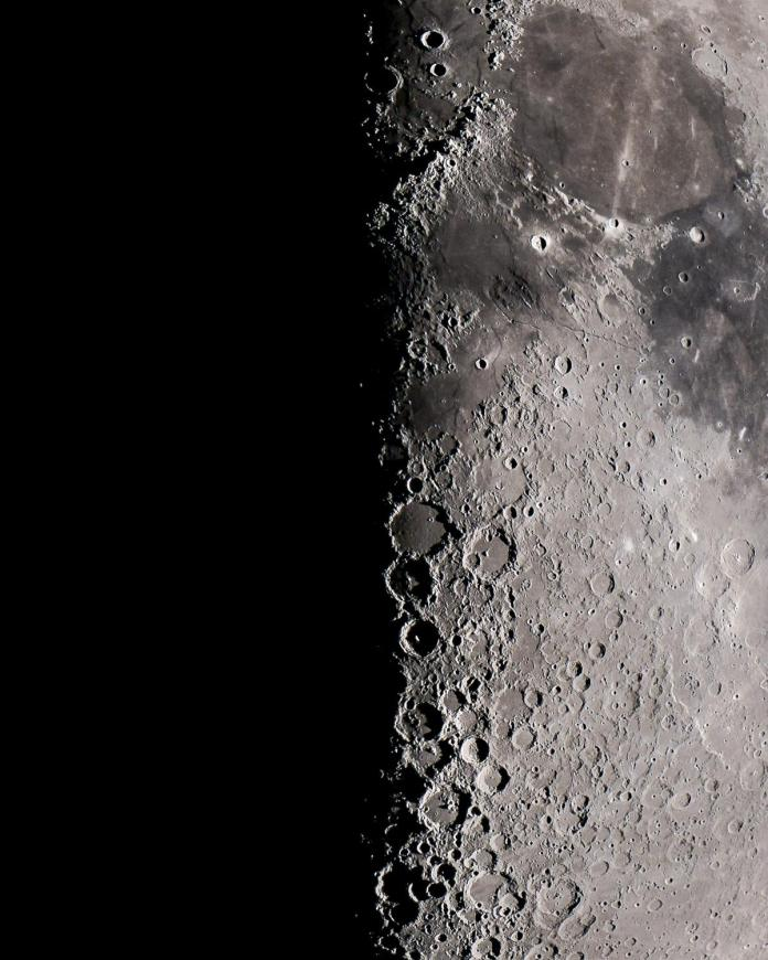 """The lunar terminator, or the line splitting night and day, as viewed through an 8""""  telescope in Enid, Oklahoma. Photo by Patrick Wine."""