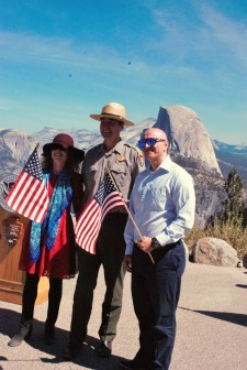 Two new citizens commemorate the moment with Yosemite National Park's acting superintendent, Chip Jenkins. Credit: NPS