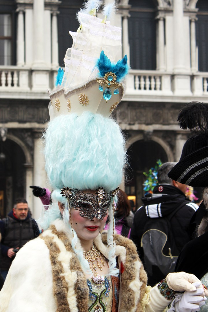 Woman with blue hair in Mask in Venice Italy during Carnevale