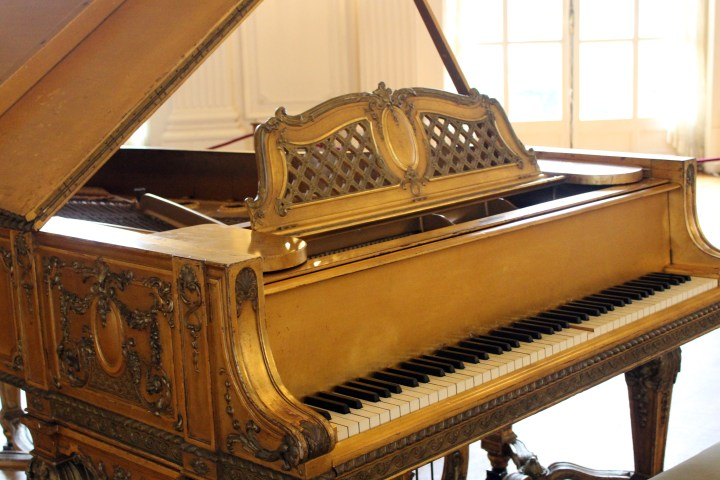 Ornate gilded piano