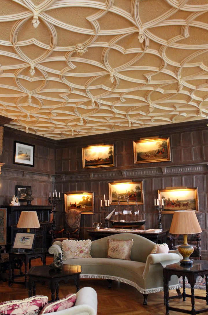 Rosecliff Mansion - Newport RI | The rich woodwork and masculine decor of this room were intended for the gentlemen of Rosecliff mansion. A model ship and fine art collection might have been worthy discussion pieces while enjoying the finest of cigars.