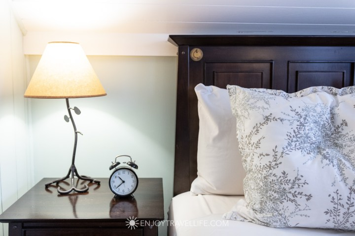 The Parsonage Inn Orleans Cape Cod Outer Cape Escape Bed and clock