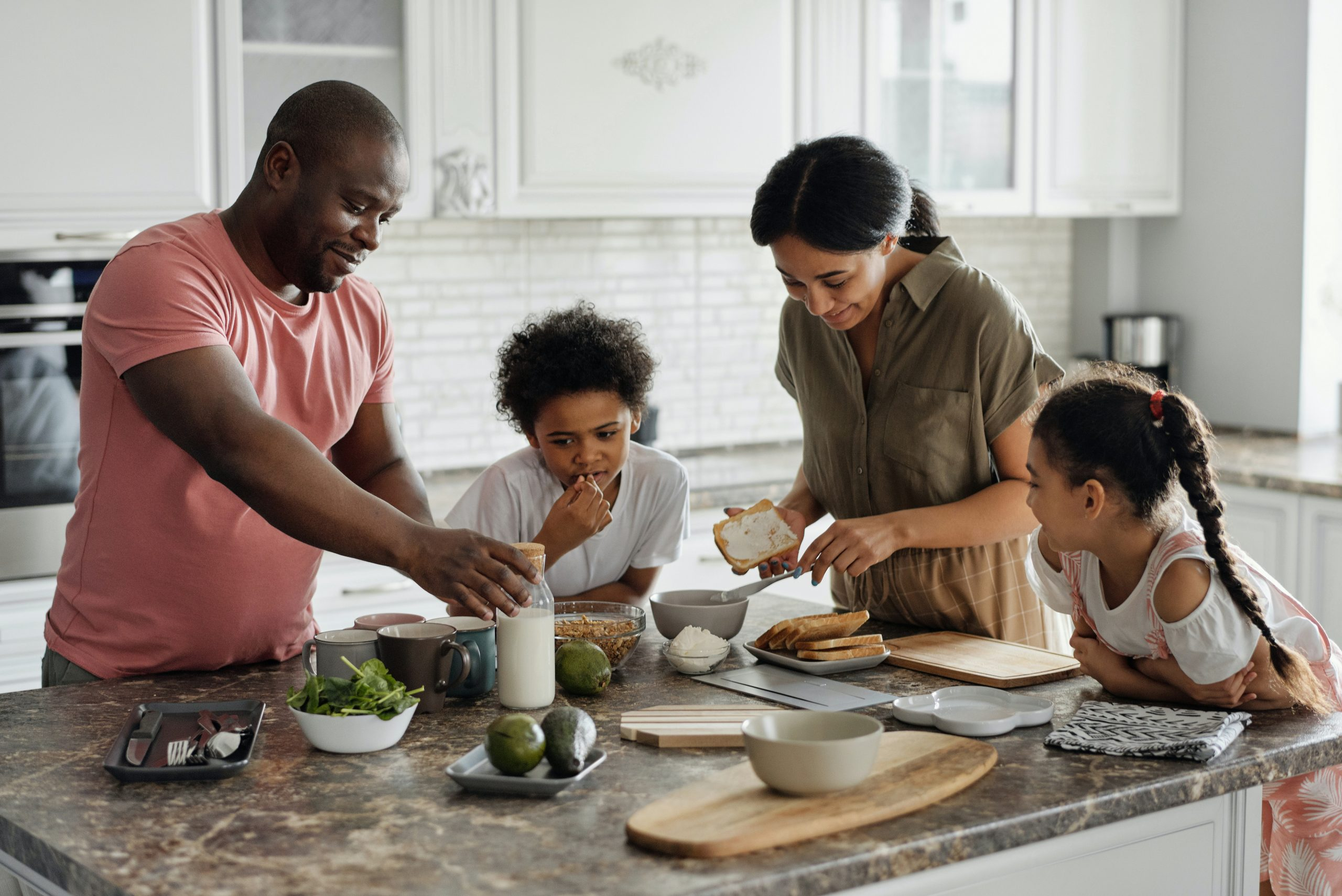 Family preparing a meal in kitchen: holiday rentals