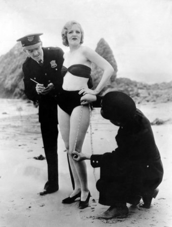bikini-laws - Policemen measuring Peggy Graves' swim suit, to check whether it meets minimum 1933 clothing requirements.