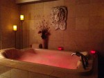 Double chaise whirlpool tub used for the Voodoo Love treatment