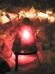 A large lit salt crystal gives you the impression you would have while in the dimly lit cave.